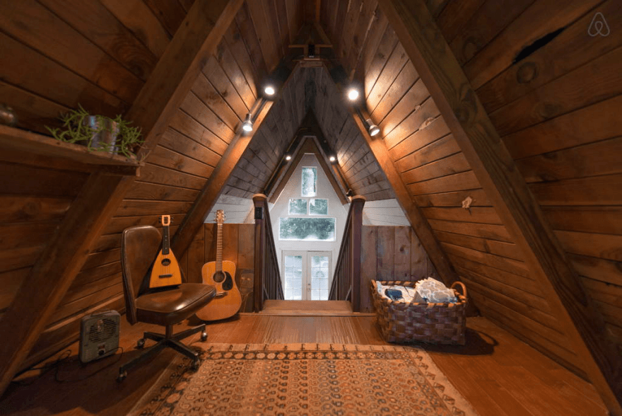 Wooden A-Frame Cabin in the Redwoods bedroom and guitar