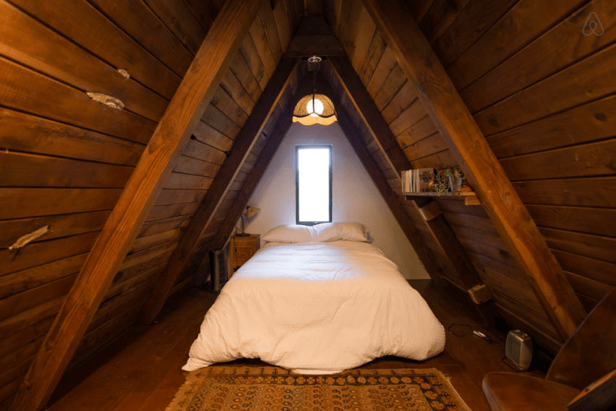 Wooden A-Frame Cabin in the Redwoods interior bedroom