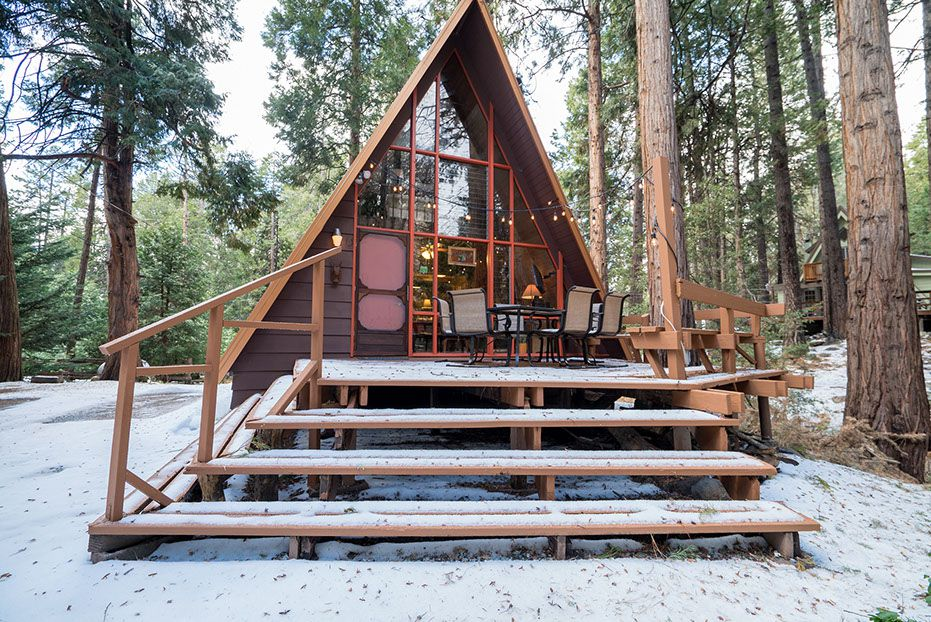 Wooden A-frame house cabin deck