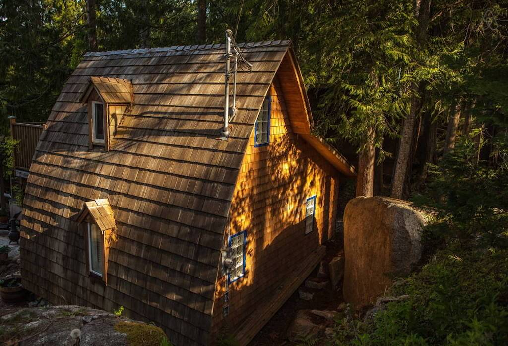 Cute exterior resembles a house from a fairy tale. The cabin has a very open layout inside. It has an ...