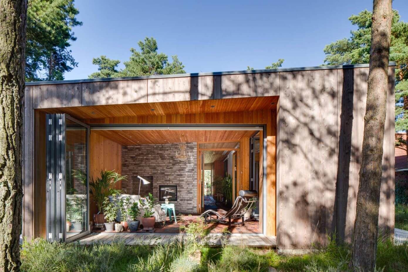 a winter garden with folding doors wood modern architecture