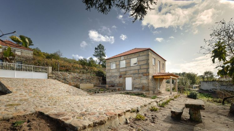 Four thick stone walls are the remaining elements of an ancient rural house. Inside, the wood structure that supports the ...