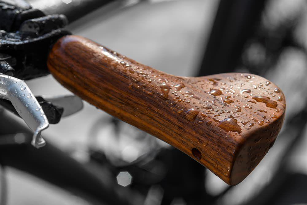 Velospring bicycle grips hide Shock-Absorbing tech in walnut wood