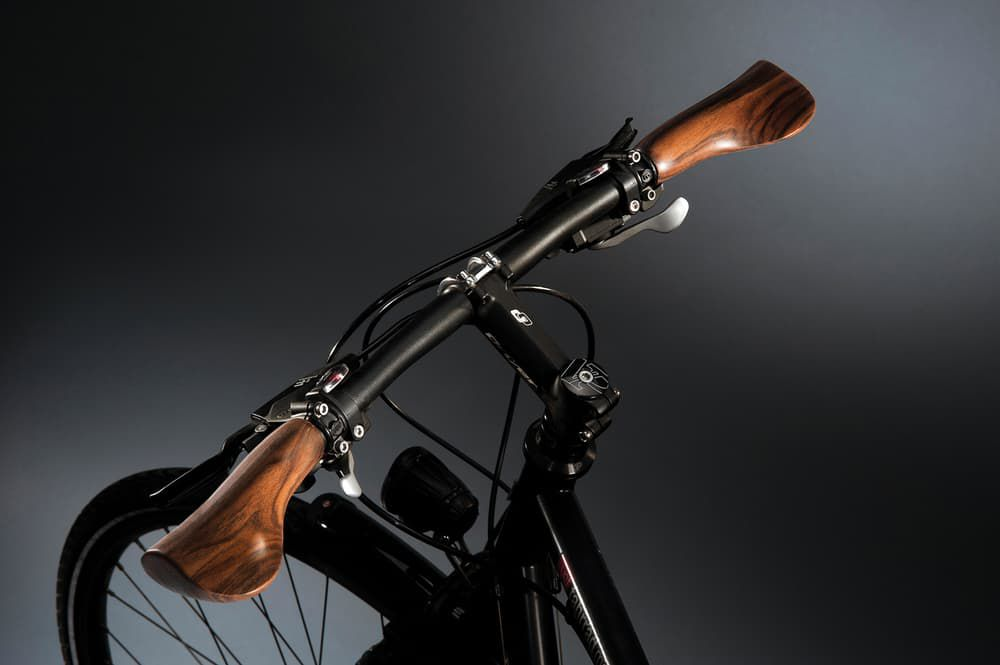 Velospring bicycle grips hide Shock-Absorbing tech in walnut wood