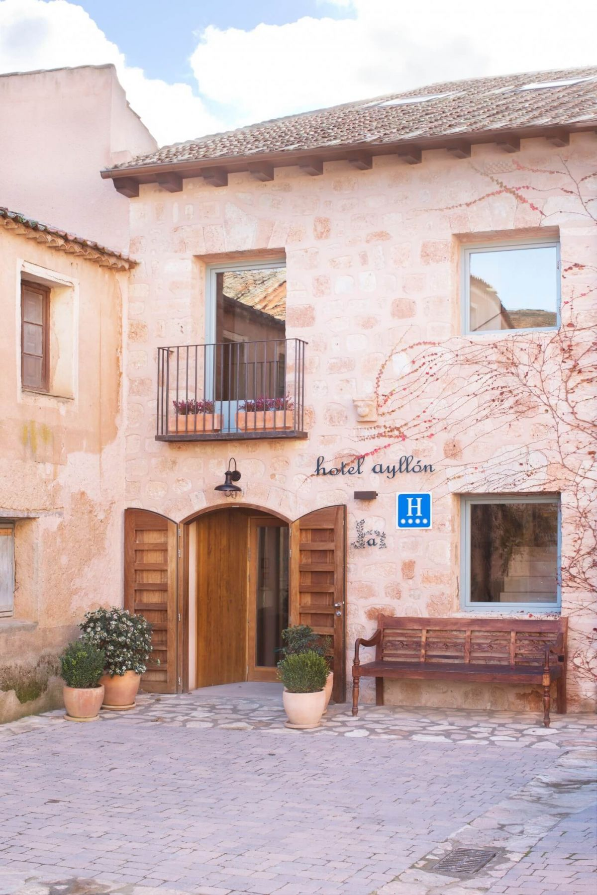 A contemporary reconstruction of the Hotel in rustic style and medieval Spanish architecture surrounding