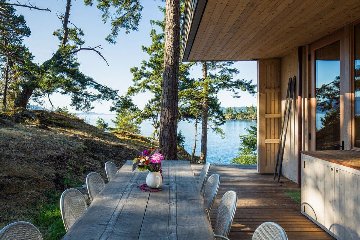 wooden open kitchen deck slab plank table exterior with a view to the ocean