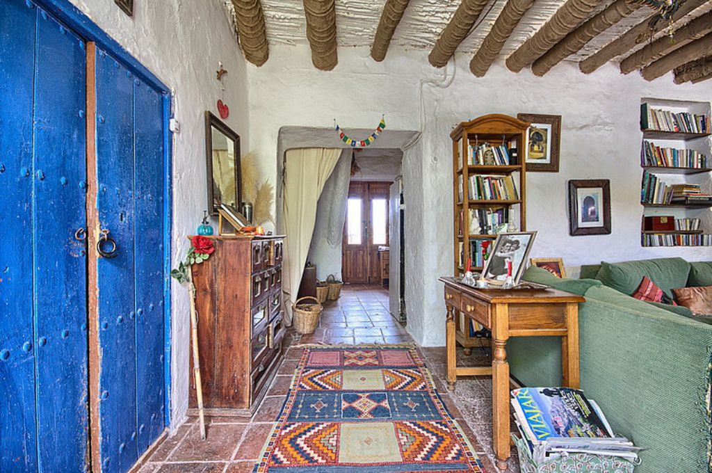 Mediterranean colorful Spanish cottage interior design - rustic furniture