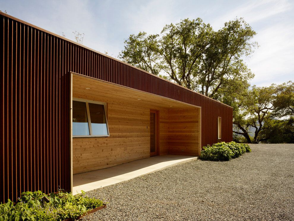 modern wooden vineyard house with green roof entrance
