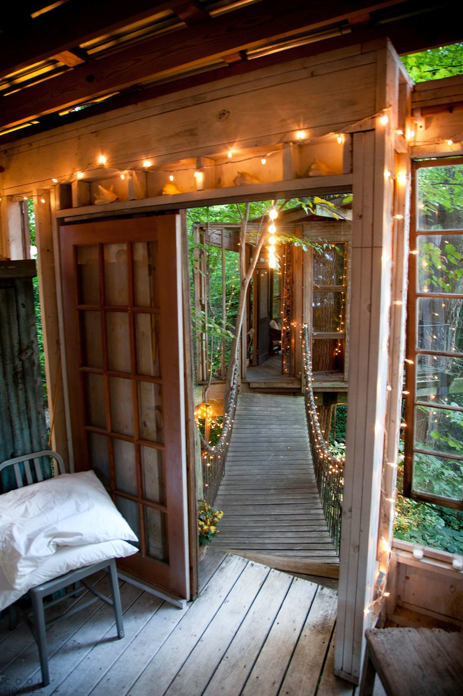 wood tree house entrance and wooden bridge