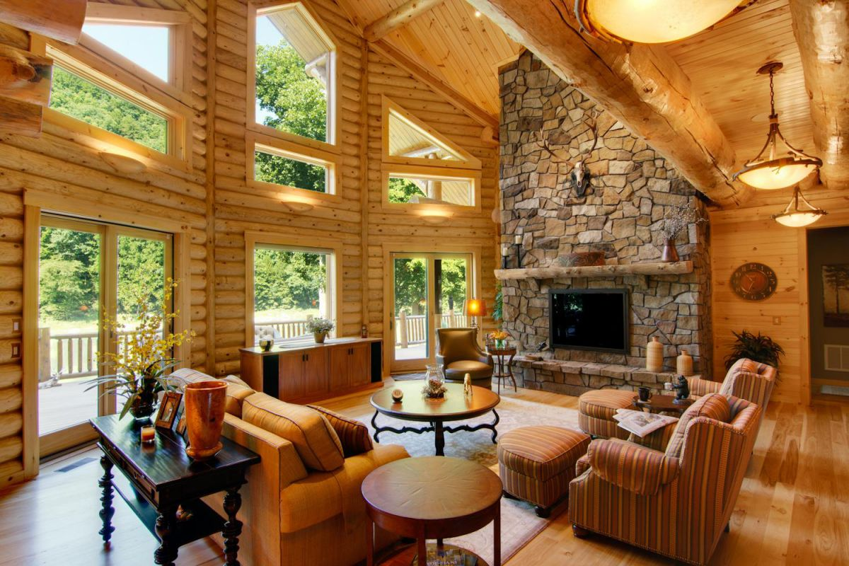 wood log house living room with stone fireplace