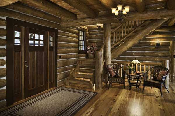 cabin interior entrance wood pillars and staircase