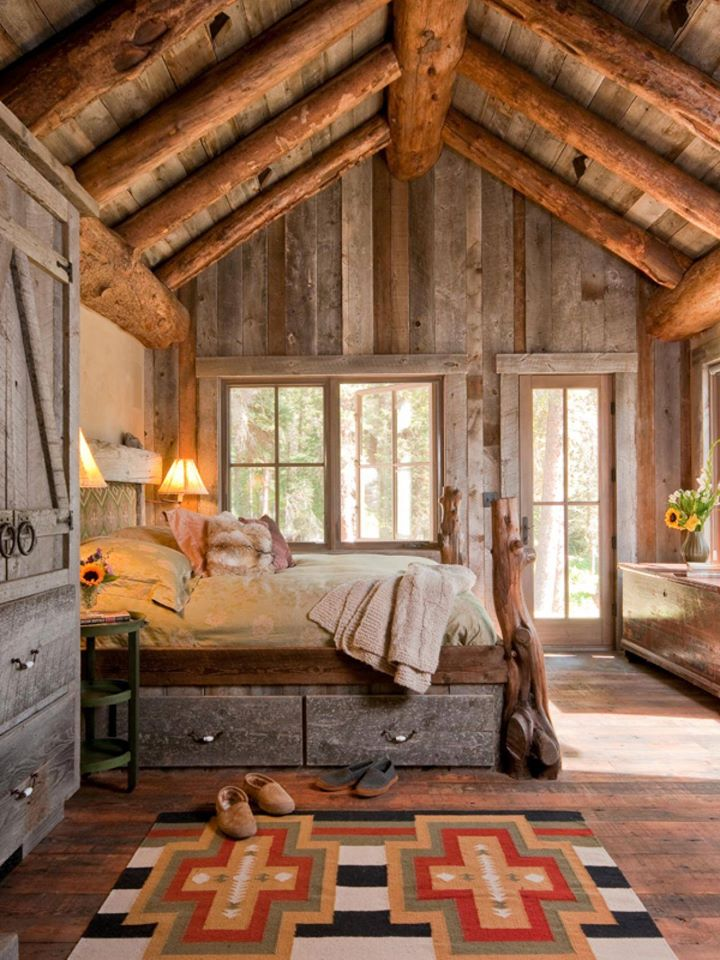 rustic log house cozy bedroom, gray washed wood walls and ceiling, log truss
