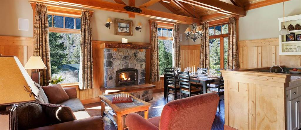 wood fireplace mantel, floor and beam ceiling, wooden table and chair, coffee table with sofa design ideas
