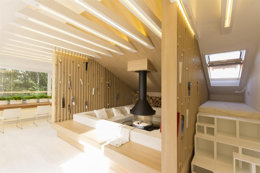 A room on the mansard floor of a 3-storied house was completely neglected, was used a storing place for old ...