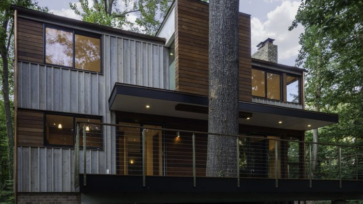 The original sixties-modern character is preserved and the renovation extends the design forward into a contemporary, modern approach. Connections to ...
