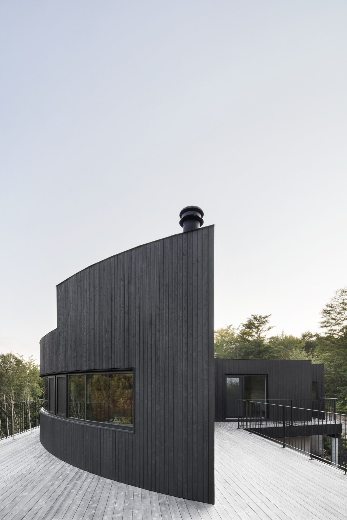 black wooden facade and open deck modern architecture