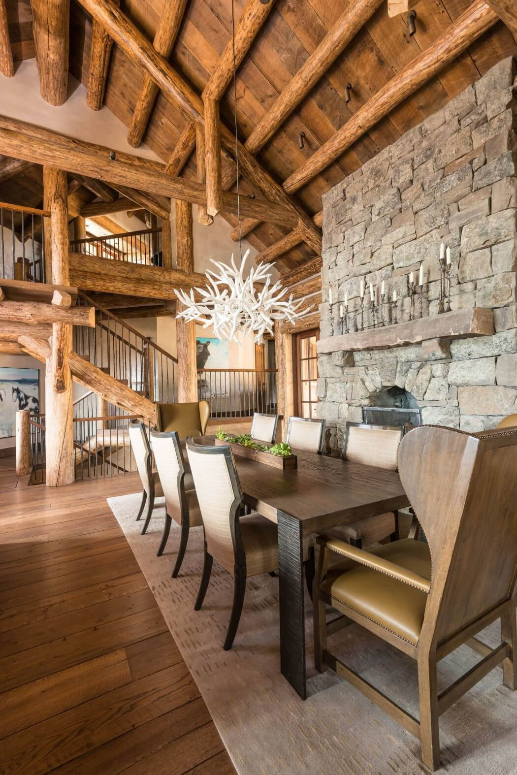 mountain log house luxury dining room with stone fireplace
