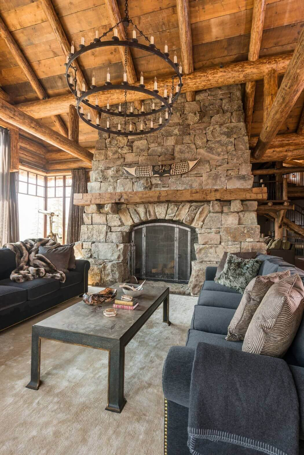 rustic sophisticated log house living room with fireplace