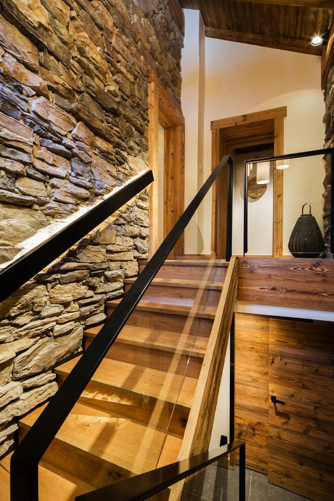 ski chalet wooden rustic alp interior staircase stone walls