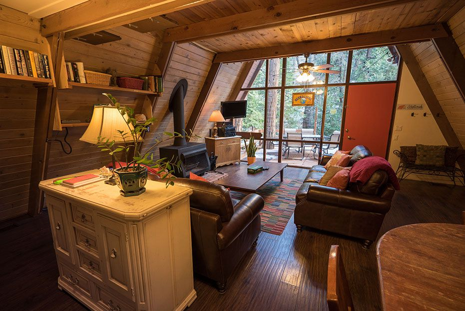 Wooden A-frame house cabin fireplace living room