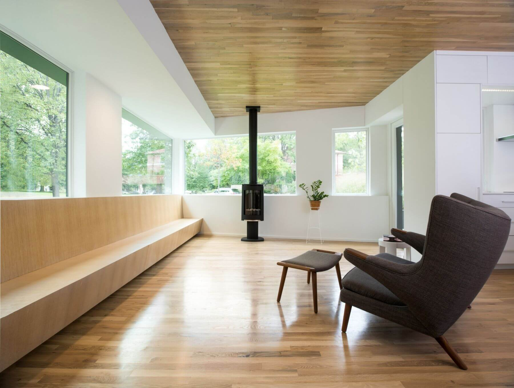 modern interior wooden floor and ceiling fireplace