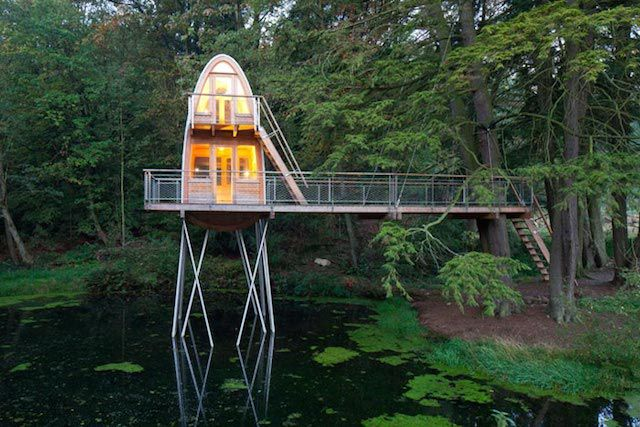 This wonderful treehouse was made in Lower Saxony. A two-storey treehouse tower is set in a pond and connected with ...