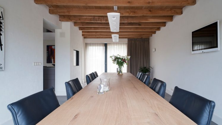 Exposed wooden columns and beams really make the atmosphere of this modern Netherlands farmhouse.