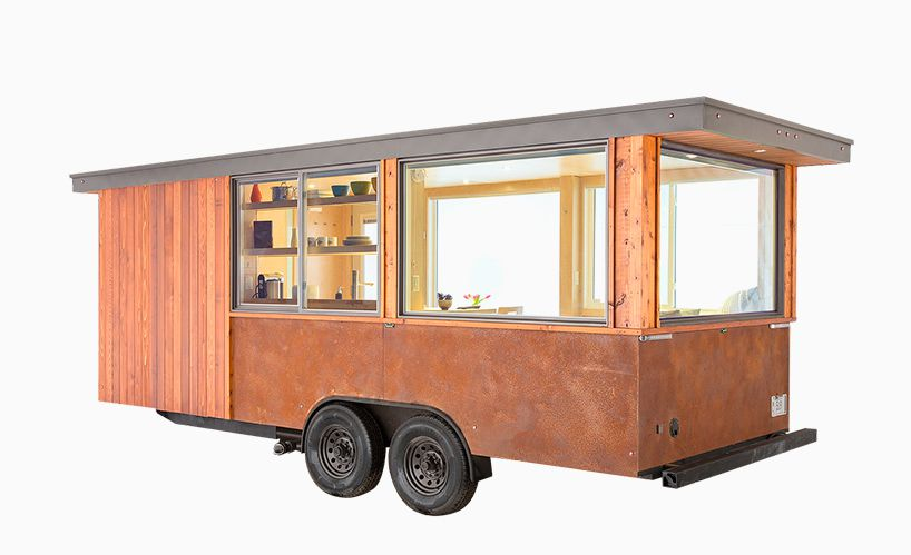small portable trailer clad with cedar wood and corten steel
