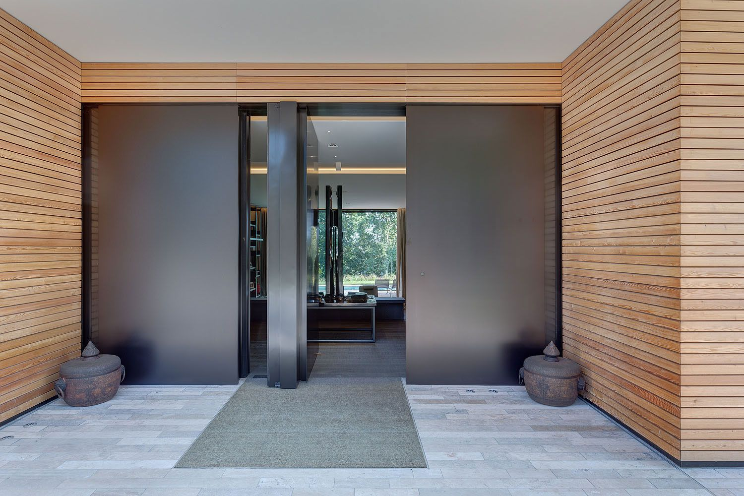 modern architecture emphasizing wooden design entrance
