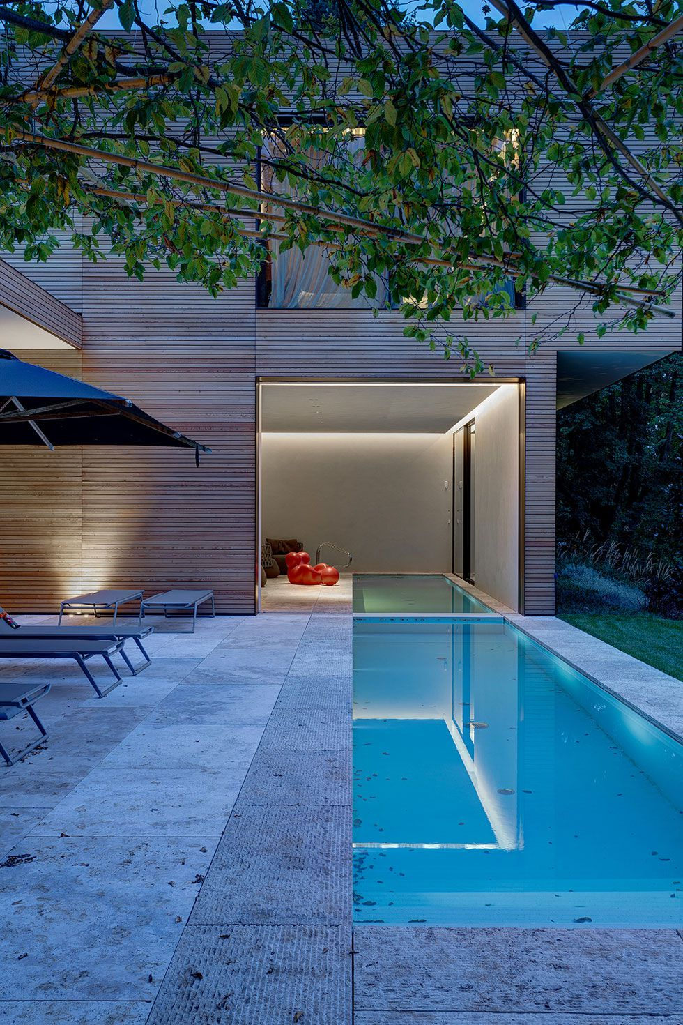 modern architecture emphasizing wooden design pool
