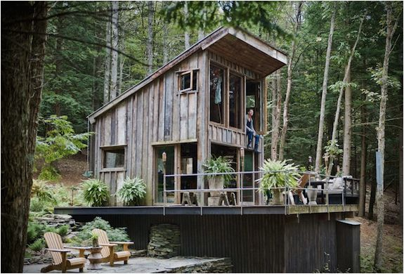 This rustic cabin was built by Scott Newkirk, a fashion stylist and interior designer based in New York. He wanted ...