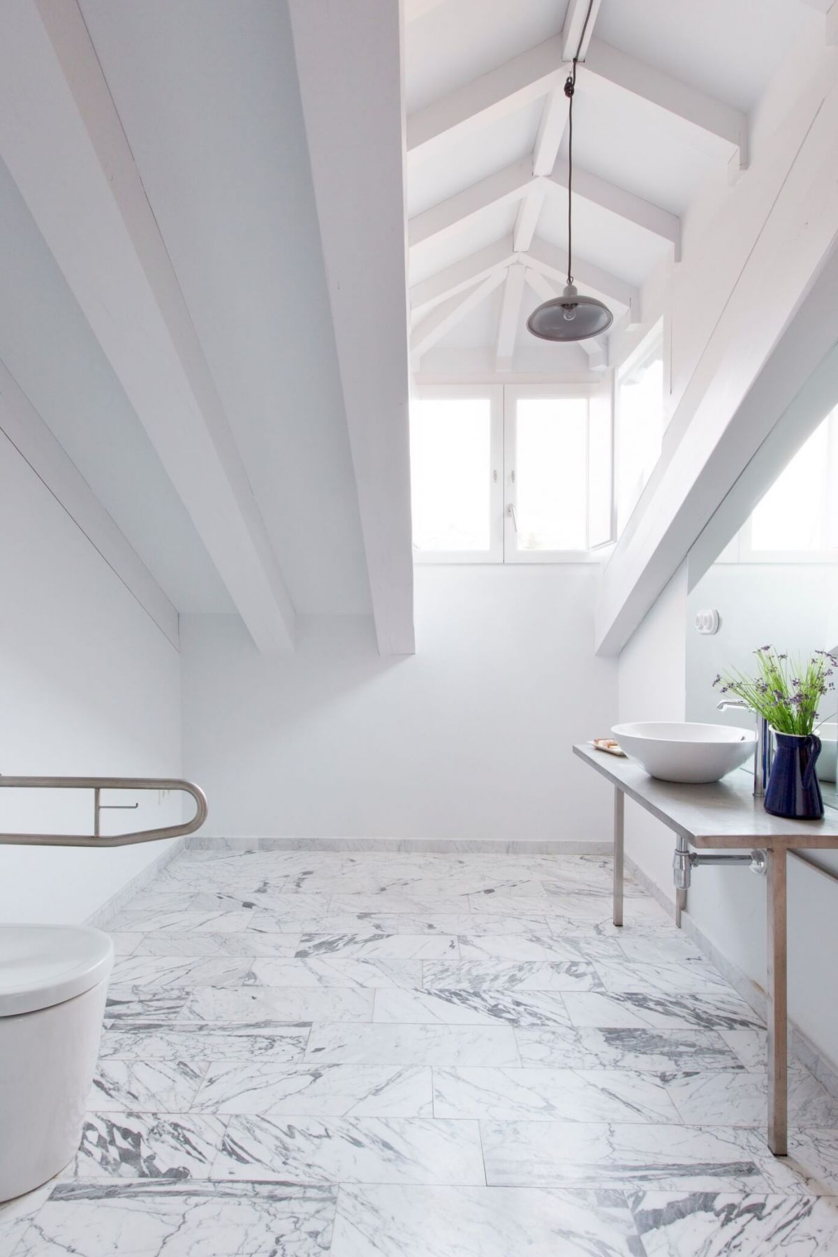 A contemporary reconstruction of the Hotel in rustic style. White bathroom interior
