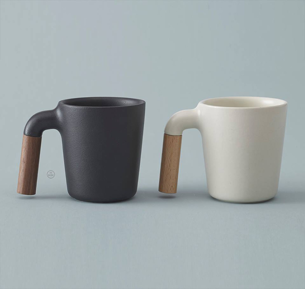 Mugr is a simple yet stylish ceramic coffee mug with a wooden handle made by HMM.