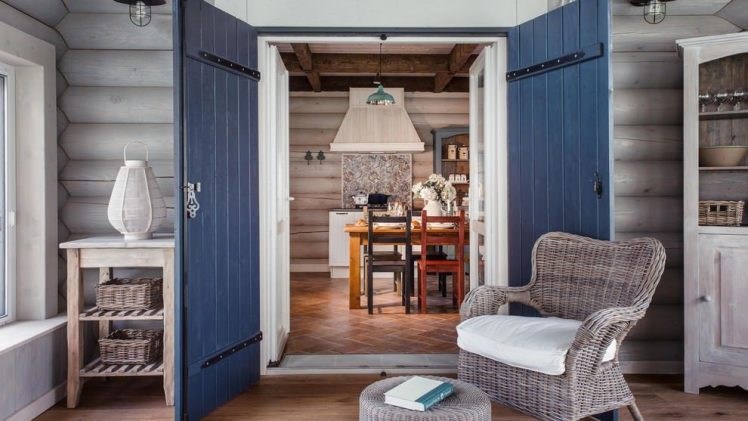 Bright interior and wooden furniture make this house a perfect combo for the summer days.