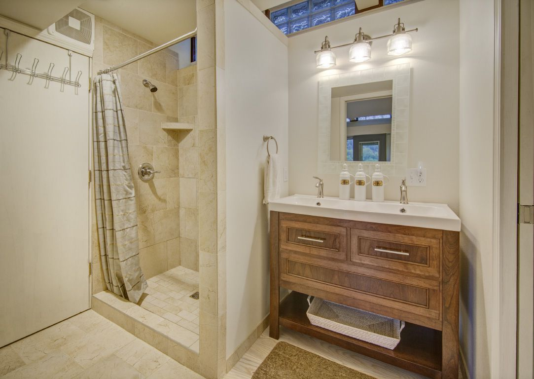 glass and wood house cabin in Madison, Wisconsin bathroom
