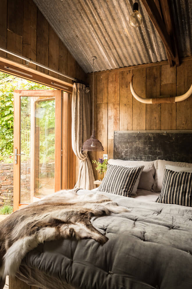A beautiful wooden cottage in North Cornwall. wooden rustic bedroom