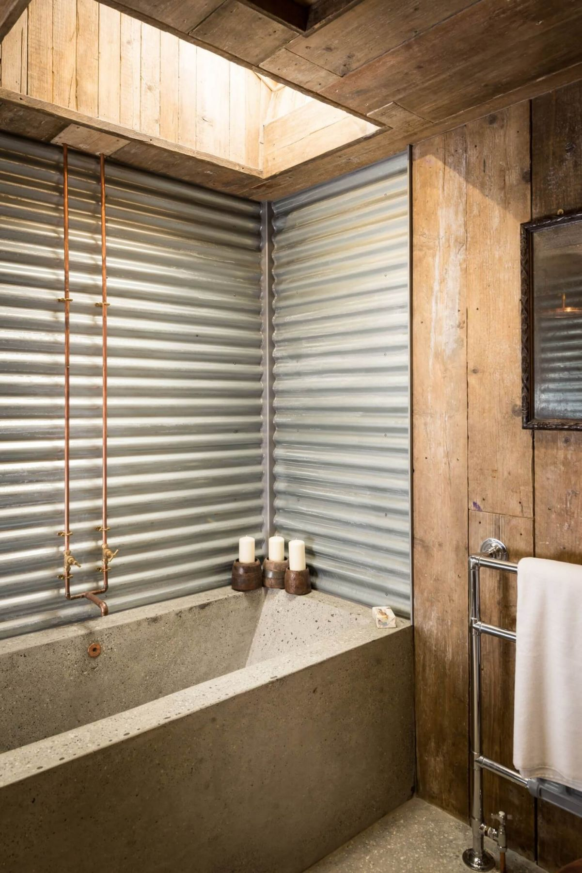 A beautiful wooden cottage in North Cornwall. wooden rustic bathroom and concrete bathtube