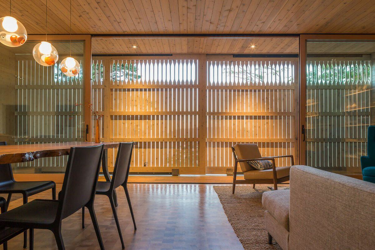 living room with closed wooden sliding doors to protect against tough weather