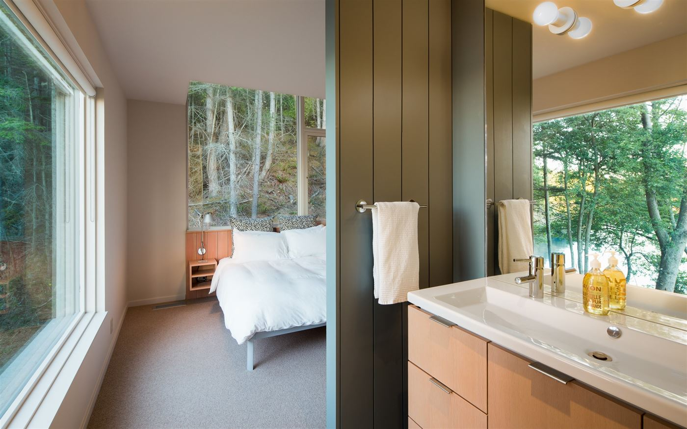 bedroom with its own bathroom in this contemporary wooden house