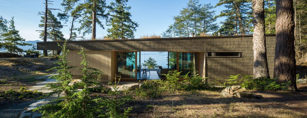 Modern wooden summer house in the woodz and the view to the ocean