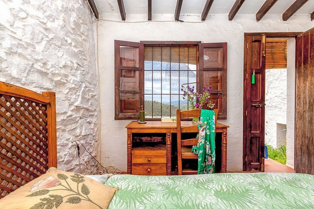 Mediterranean colorful Spanish cottage - rustic bedroom with a view