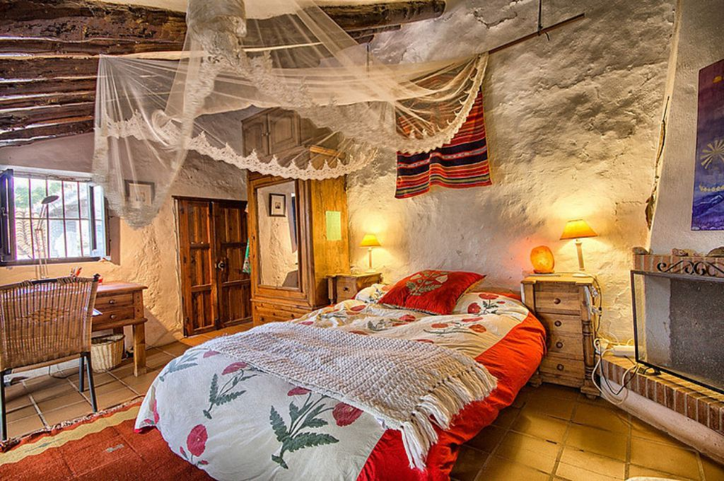 Mediterranean colorful Spanish cottage - rustic interior design master bedroom