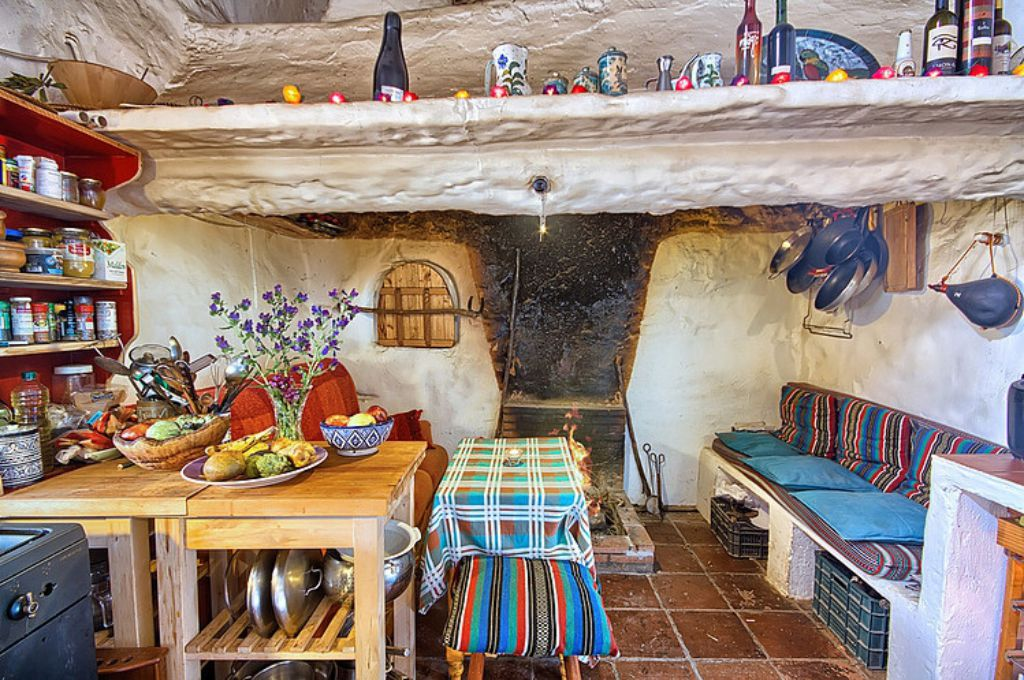 Mediterranean colorful Spanish cottage - old fireplace living room