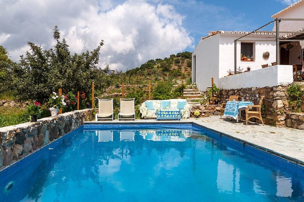 Mediterranean colorful Spanish cottage countryside swimming pool exterior