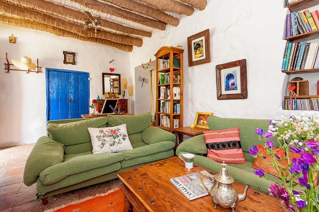 Mediterranean colorful Spanish cottage - greem couch living room