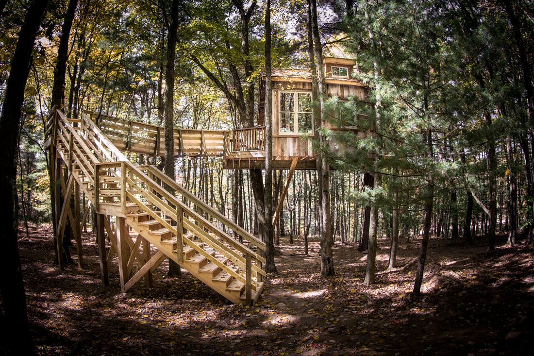 The treehouse located in the middle of the woods, nestled high above the valley at the Mohicans.
