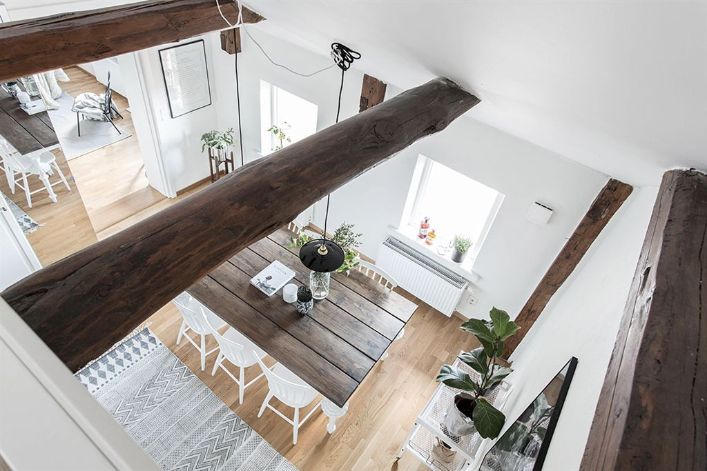 massive wooden beams reflecting modernity with a rustic touch