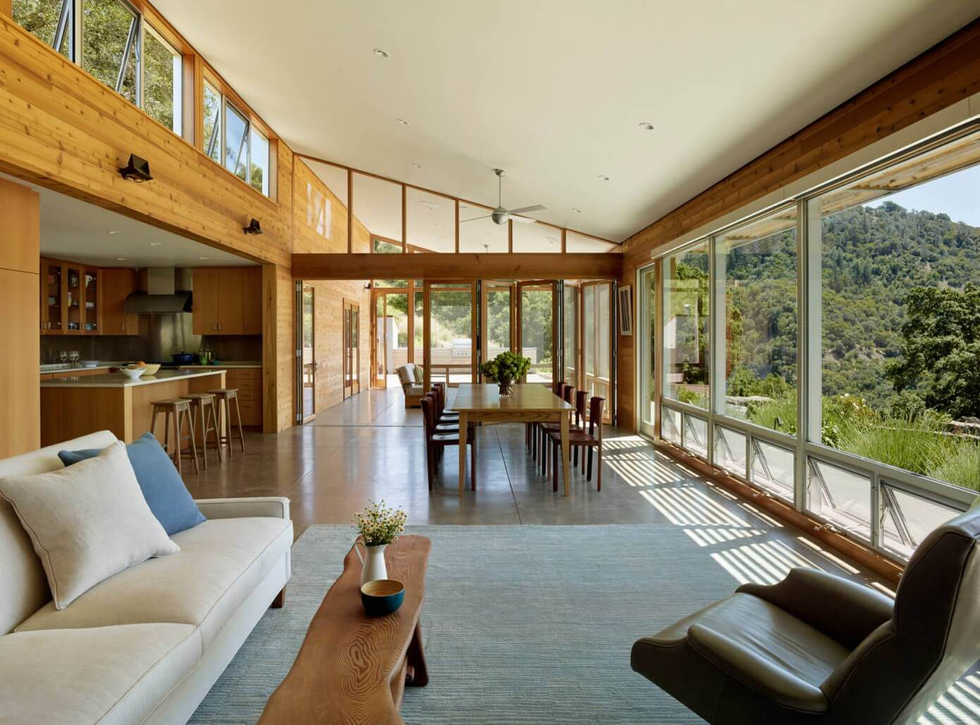 open living room with wooden interior deisgn and striking view
