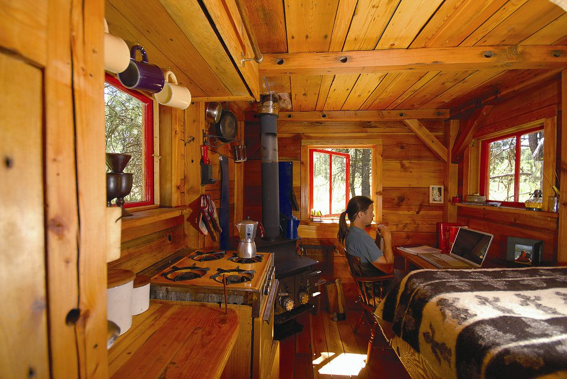 wooden hut cabin small living room and bedroom with fireplace