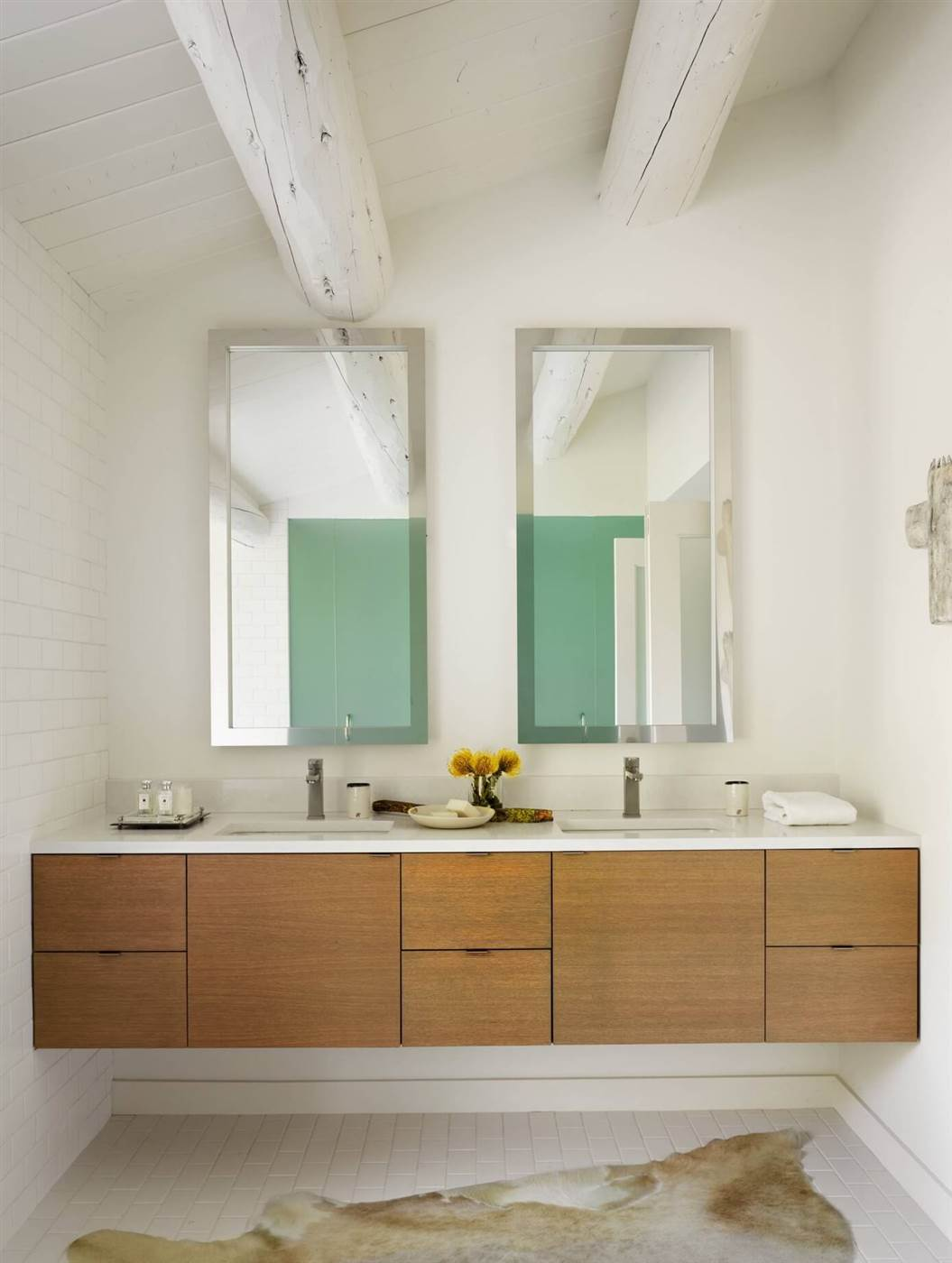 white contemporary bathroom with wooden drawers as the main focus